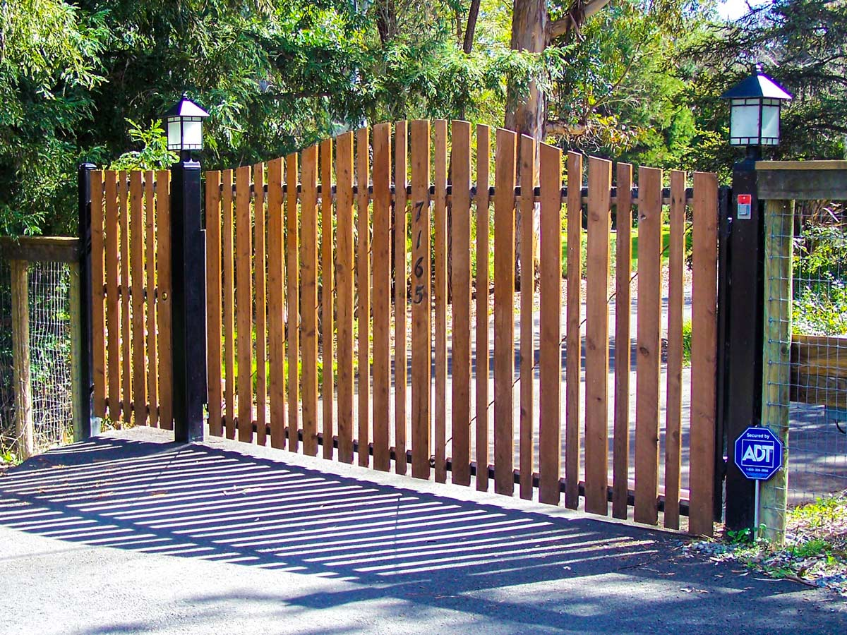 DiFranco Gate & Fence - Residential & Commercial Custom Automated Gate Contractor - Arched top cut redwood picket-single swing-on pc black steel frame automatic gate automatic gate - Forestville CA