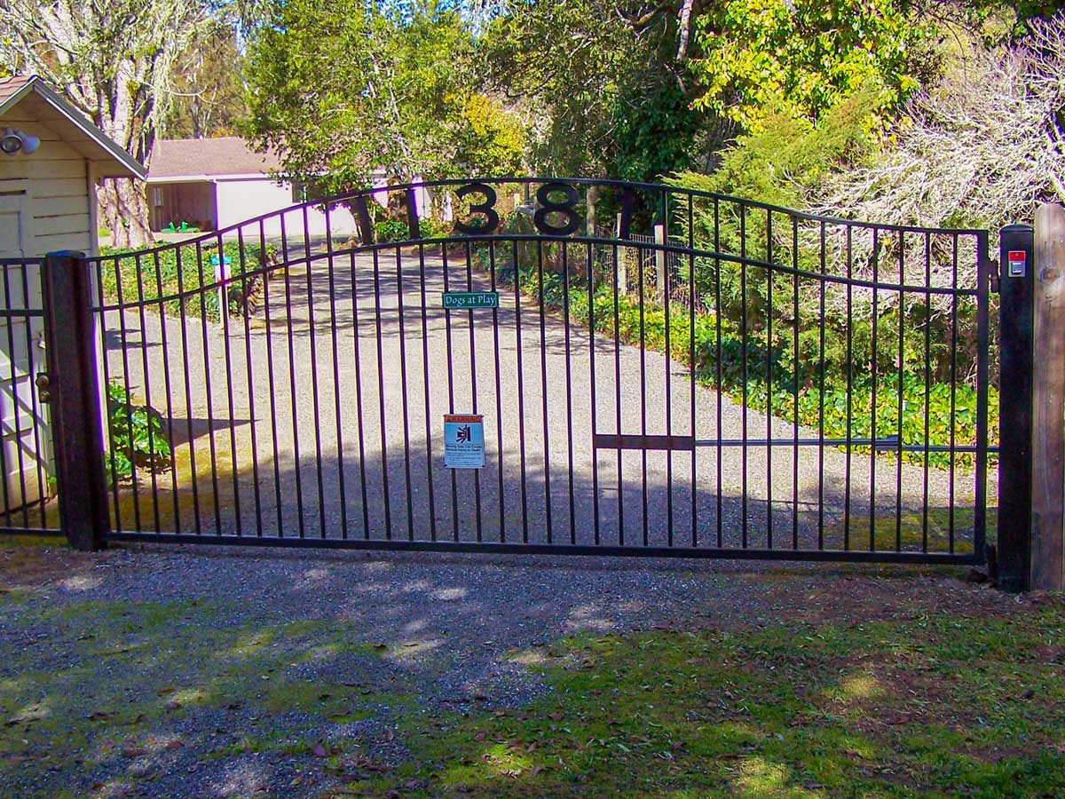 DiFranco Gate & Fence - Residential & Commercial Custom Automated Gate Contractor - Ornamental Iron - Executive Style double-compound arched top single swing automatic gate - Rohnert Park CA