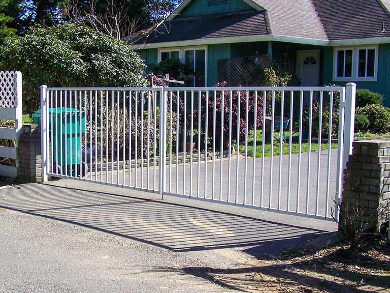 DiFranco Gate & Fence - Residential & Commercial Custom Automated Gate Contractor - Ornamental Iron - Western Style double swing steel frame with a white paint finish automatic gate - Sonoma County CA