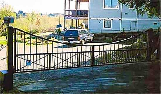 DiFranco Gate & Fence Company - Custom Ornamental Iron Driveway Gates - Custom Scalloped Design - Solar-Powered - Automatic Driveway Gate - Sebastopol, CA