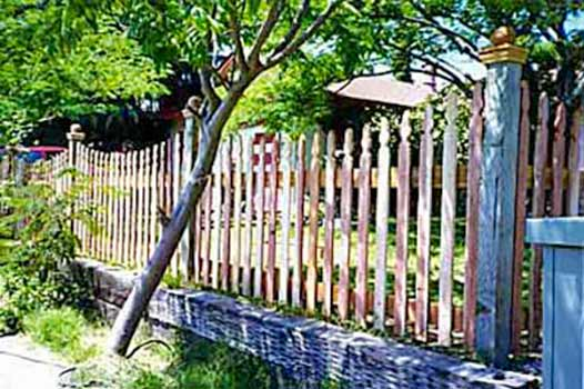 DiFranco Gate & Fence Company - Custom Built Picket Fences - Formed Scalloped Recessed Picket Fence with Post Caps - Sebastopol, CA