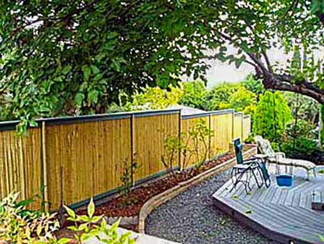 DiFranco Gate & Fence Company - Custom Bamboo Fences - Recessed Bamboo Fence with Trim Stained Posts - Healdsburg, CA