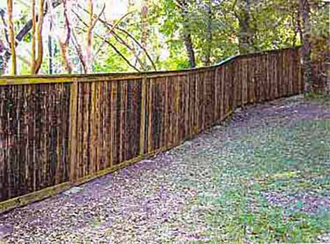 DiFranco Gate & Fence Company - Custom Bamboo Fences - Recessed Bamboo Fence with Trim Stained Posts - Forestville, CA